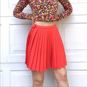Crepe sunburst Pleated skirt in Coral.